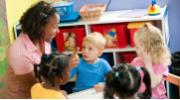 Caregiver with children at daycare
