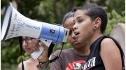 Youth advocate states her opinion through a megaphone
